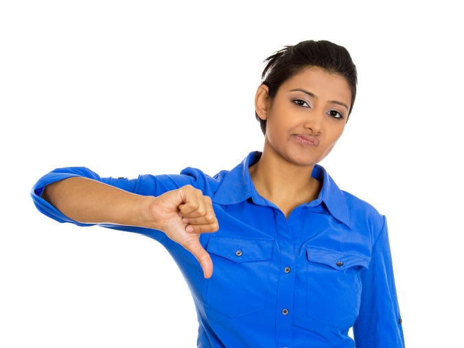 Unhappy woman giving thumbs down