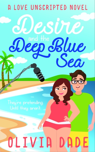 "Cover for DESIRE AND THE DEEP BLUE SEA by Olivia Dade, with the tagline ""They're pretending. Until they aren't."" At the top of the image, the text is: ""A LOVE UNSCRIPTED NOVEL."" The image shows a curvy, pretty woman and a taller man in glasses standing by the seaside with palm trees in the background and a boom mic overhead."