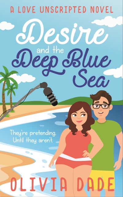 """Cover for Olivia Dade's Desire and the Deep Blue Sea: A couple on the shore with palm trees behind them and a boom mic overhead. The tagline reads """"They're pretending. Until they aren't."""""""